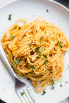 Vegan OnePot Pumpkin Pasta is part of Pot recipes easy - Creamy, festive vegan pumpkin pasta that comes together all in one pot! A quick and easy fall meal that takes less than 30 minutes to make! Pumpkin Pasta, Vegan Pumpkin, Pumpkin Pumpkin, Fall Recipes, Whole Food Recipes, Christmas Recipes, Healthy Cooking, Cooking Recipes, Sauce Pizza