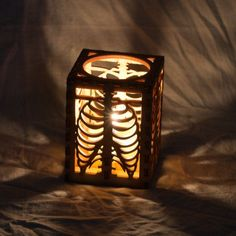 """Tea light luminary made of laser cut wood. Rib Cage design converted from original drawing.    Hand crafted and designed in Seattle, Washington. """