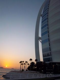 Sunset over the Burj Al Arab Dubai. Such an unusual architecturally structured hotel, built on sand, with a beautiful sunset in the background. Nature and Technology in harmony
