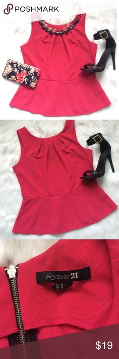Forever 21 fushia pink peplum top Forever 21 fushia pink peplum top size M.  excellent condition. Back zipper. bundle and save Forever 21 Tops Blouses