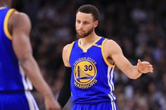 Stephen Curry of the Golden State Warriors high fives Ian Clark in the first half against the San Antonio Spurs during Game Four of the 2017 NBA...