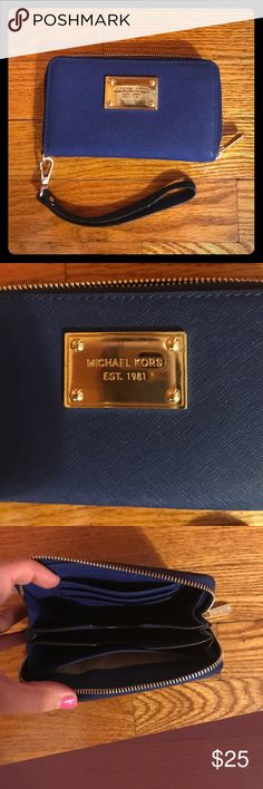 Michael Kors Navy Blue Clutch Fits a 5s iPhone - doesn't fit 6, 7 or plus. Don't know about androids. MICHAEL Michael Kors Bags Clutches & Wristlets