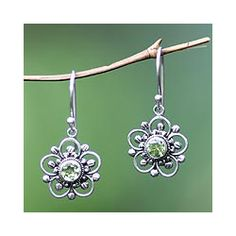 @Overstock - Sterling Silver 'Nature's Gift' Peridot Flower Earrings (Indonesia) - Known as 'nature's spring time gift,' peridot glows at the center of these flower earrings. Indonesia's Nyoman Rena designs these earrings, which are crafted by hand with sterling silver.  http://www.overstock.com/Worldstock-Fair-Trade/Sterling-Silver-Natures-Gift-Peridot-Flower-Earrings-Indonesia/6341068/product.html?CID=214117 $35.49
