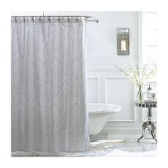 Scrolling lotus blossoms in metallic silver add a hint of subtle shimmer to this crisp white cotton shower curtain from Charisma.