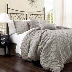Lake Como 4-Piece Bedding Comforter Set. In taupe maybe gray with 2 square black & white chevron pillows and one rectangle teal pillow
