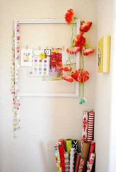 cute idea for the kid's art display in the kitchen