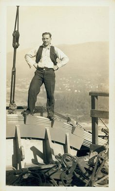 This guy standing on a bridge under construction. | 23 Completely Random Old Photos Of People Standing On Things
