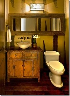 Look for soft yellow wall paint for western decorating. Gold tones are perfect for this bathroom.   Stylish Western Decorating