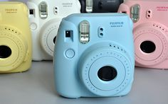 These retro instant cameras print pocket sized photos that develop before your very eyes! Great fun at parties. Instax Mini 8 Film, Fuji Instax Mini 8, Instax Mini 8 Camera, Fujifilm Instax Mini 7s, Polaroid Camera, Toy Camera, Film Camera, Typical Girl, Pastel Colours