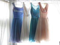 I really think I like the idea of mismatched bridesmaid dresses.