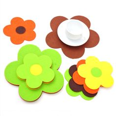 flower shape wool felt coaster. wool felt coaster can also be used for heat insulation for pans or bowls. Unique design and various colors.