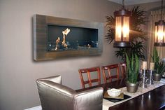 Companies like HearthCabinet, NuFlame and Napoleon Fireplace make clean-burning fireplaces for apartment-friendly fires.