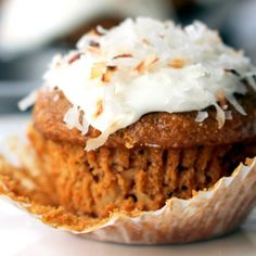 A Healthy Whole Grain Carrot Coconut Morning Glory Muffin sitting on top of a white plate.