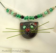 Black kitty pendant Polymerclay cat necklace by CrumpledFantazies