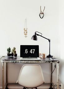 Inspiring working desk for any design lover, black rustic lamp, shabby chic metal table. Small desk cacti and wall details.