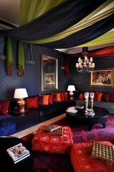 Marvelous Moroccan Living Room Decor Inspirations: Luxury And Colorful Moroccan Living Room With Black Grey Sofa Also Beautiful Chandelier And Red Blue Carpets ~ kimont.com Living Room Inspiration