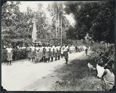 Date: 1930 Pall bearers and Mau police carrying the coffin of Tamasese photographed by Alfred James Tattersall
