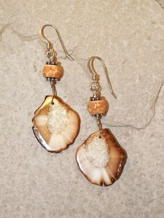 """Handmade fossil walrus ivory earrings, set with sterling silver hooks, and smaller fossil walrus ivory bead. Size: 2""""H Including Hook  Price: $45.00 -- on ScrimshawGallery.com #jewelry #earring #ivory"""