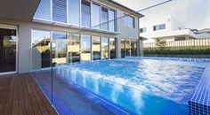 home with new glass swimming pool