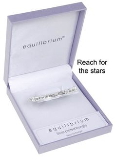 """Equilibrium Silver Plated Hinged Bangle - Reach for the stars.A beautiful silver plated hinged bangle with a special message inscribed on it  """"Reach for the stars""""  The equilibrium jewellery makes a very special personal gift with a sentimental message ... a gift with meaning  This bangle is hinged, to allow easy wear, and is in a wave design.  There are also little clear accents between each inscription, which adds a real touch of class.  It also comes in a beautiful padded gift box, and…"""