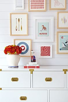 Create a kid-inspired gallery wall by framing book illustrations, drawings and geometric patterns in similar colors. The result will be an eye-catching display that's young at heart. Click through for more home decor inspiration from this beautiful and beachy New Jersey home.