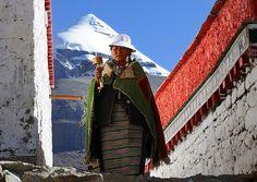 Pilgrim circumambulate the Choku monastery, Kailash in the background. Tibet by reurinkjan, via Flickr