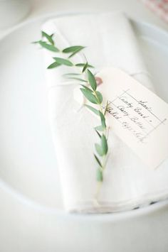 white minimal and organic place setting with simple greens