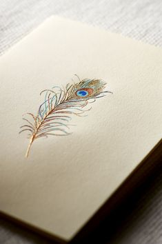 Plumage perfection in a single feather, engraved in vibrant blues, greens and, of course, gold.