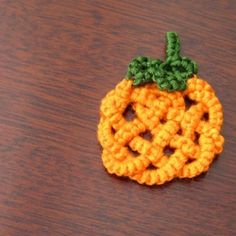 Halloween pin from free tatting pattern that uses Celtic knots to create a festive pumpkin