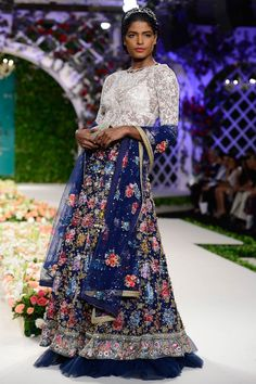 Blue and ivory fully embroidered floral lehenga set By Varun Bahl