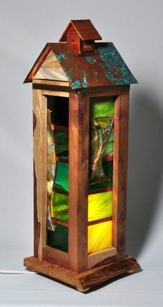 Cocobolo wood from South America and reclaimed wormy Chestnut base with green stained glass and clipper top with cedar finial