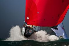 charging downwind under a bright red spinnaker