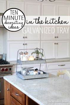 Minute Decorating Ideas – In the Kitchen... decorate your kitchen island with a galvanized tray with all of the essentials!   via Finding Home