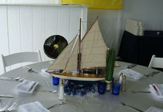 Sailboat centerpiece, add a mirror under the sea glass and some tea lights