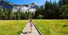 Girl walking on a footpath in Yosemite Valley © Geri Lavrov/Photographer's Choice RF/Getty Images