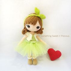 Amigurumi crochet doll in pretty dress with crochet bow. (Inspiration).