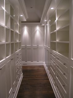Master Closet. Really like the surrounding can lights. Maybe one in each corner and a small chandelier. Bookshelf lighting would get in the way of top storage.
