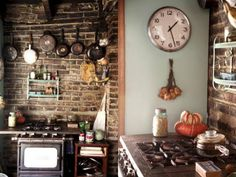 Moon to Moon: Kitchen's with Character Old gas stoves & brick, love it - although I'd go with a lighter (non-red) shade of brick...