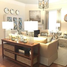 My cream and pale blue family room. Mixing stained and painted wood, metal, and upholstery for balanced interior design. Notice the blue painted ceiling oh and my dog's pale blue toy :)
