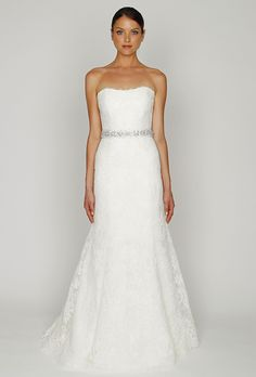 Brides: Bliss by Monique Lhuillier. Ivory re-embroidered lace strapless modified trumpet gown with beaded belt.��More Details From Bliss by Monique Lhuillier