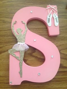 Awesome DIY gift!! (I gave it as an end of the year goodbye gift to a senior in my dance class) -I bought a white letter S in Michaels (it has a little place on the back so you can hang it up on the wall) -I spray painted it pink -I found the CUTEST dance stickers in Michaels that I'm so obsessed with (it came with the jewels too) Super easy to do and so crafty!! Everyone loved it... I think I might make one for myself :)