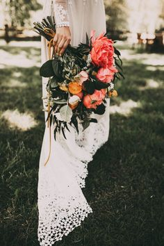 I love the contrast of dark greens and bright blooms in this one! // Spring bloom inspiration from the sweetest backyard wedding we've ever seen | Image by India Earl
