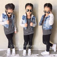 She feels cool today with her cute pigtail braids Outfit deets: Sunnies from @fashionkidstore Top from @oldnavy Jacket from @target Leggings from @hm Studded converse from @spikedcons #ootd