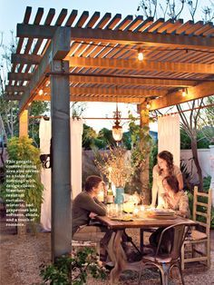 Gorgeous lighted pergola--curtain rods on outer posts
