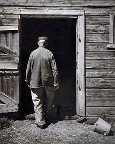 Wright Morris: Uncle Harry Entering Barn, Home Place, 1947