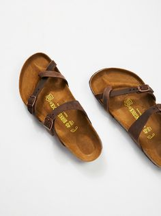 Mayari Leather Birkenstock | Strappy Birkenstocks with a classic molded footbed. * Crisscross oiled leather straps * Toe loop * Buckle detailing * Regular: C-D Width
