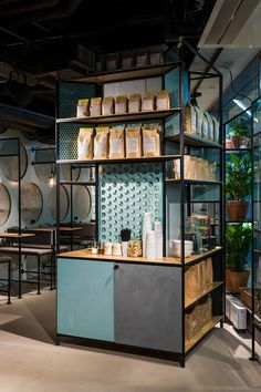 The HYY Group opened a new vegetarian café called WELL COFFEE in the centre of Helsinki. Bond designed a complete experience around the visual identity. Coffee Shop Design, Cafe Design, Signage Design, Store Design, Coffee Display, Coffee Instagram, Counter Design, Coffee Store, Coffee Plant