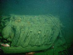 Submerged view of one of eight German built Maybach 12 cylinder gasoline engines that served as the propulsion system for the airship. During the 2006 expedition five Maybach engines were located and recorded.  (Photo Credit NOAA-MBNMS/MBARI)