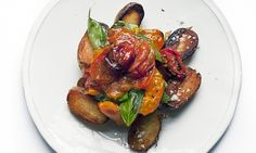 sauteed potatoes and tomatoes on white plate