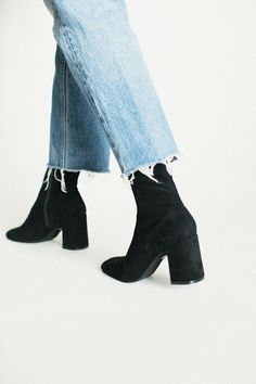 Black booties and frayed denim